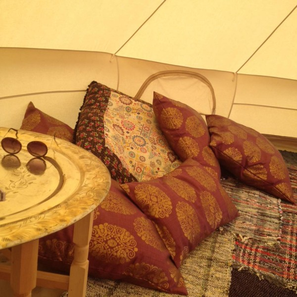 An image with a cluster of cushions and pillows in one of the Brook Bell Tents