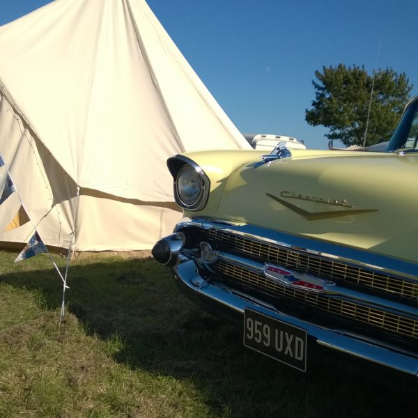 Brook Bell Tents Glamping with a classic car at Retro Festival