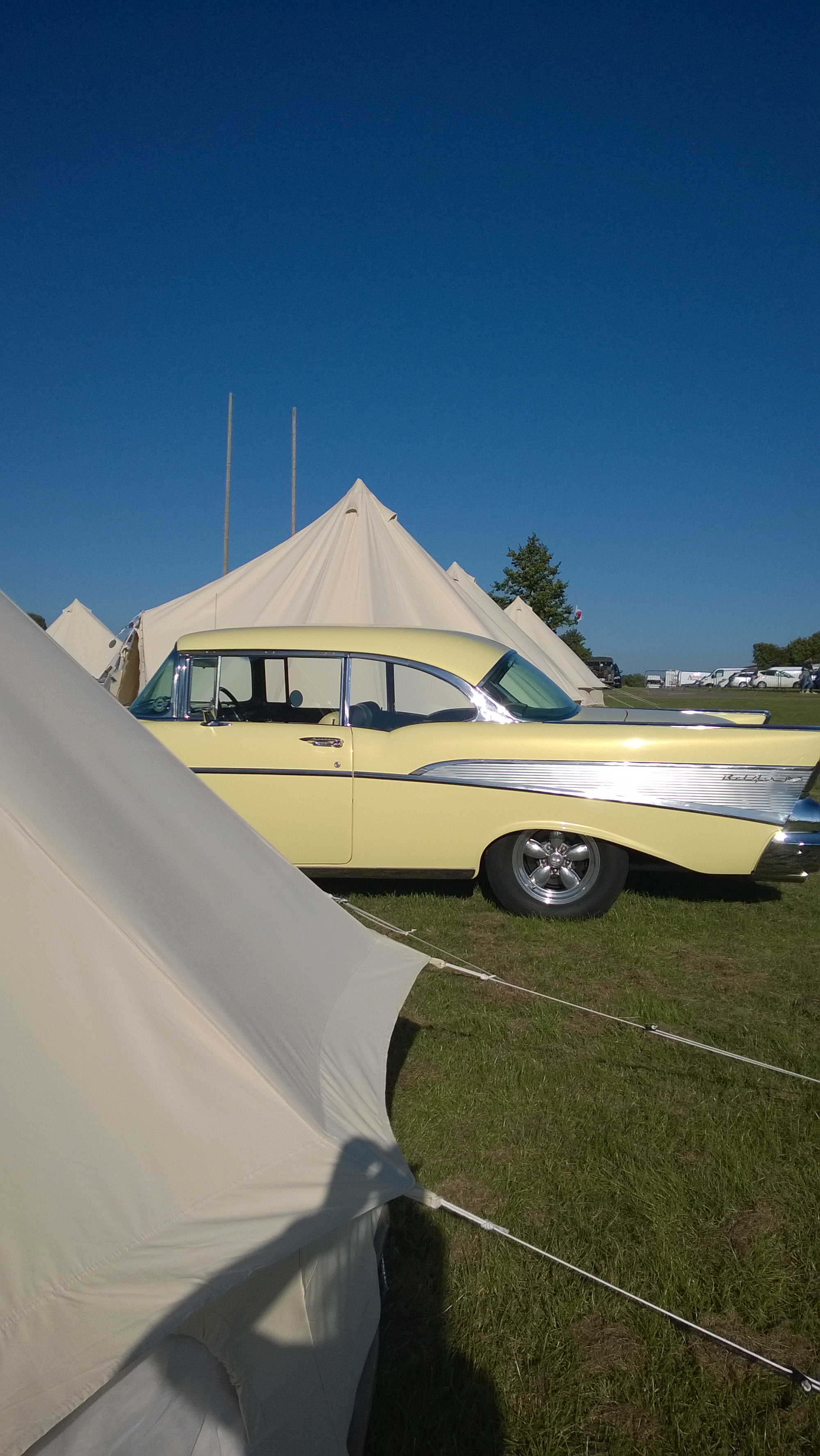 Classic car next to a bell tent